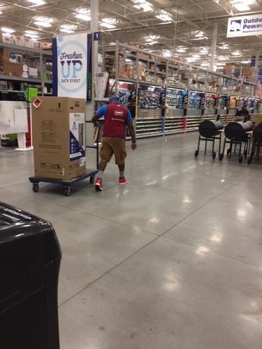 Lowe's Employee rolling water heater.jpg