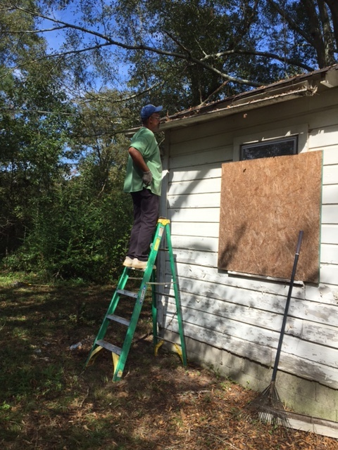 Victor working on gutters