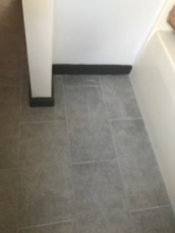 bathroom tile beside tub