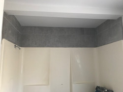 bathroom tile above tub