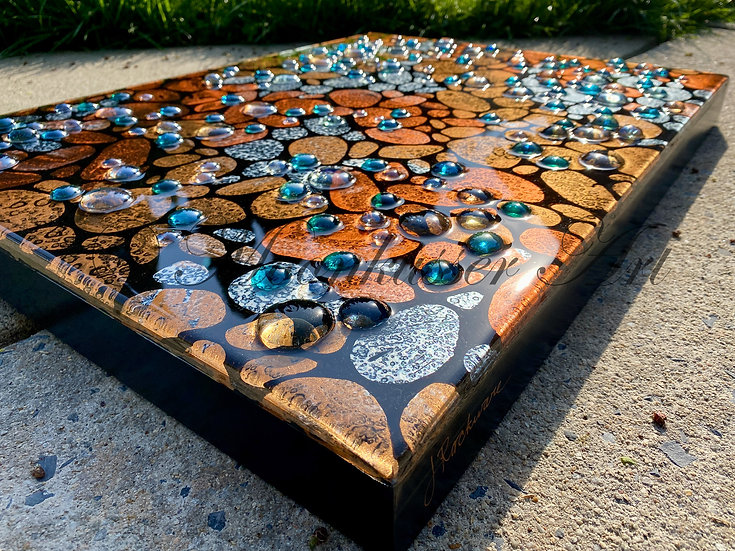 Abstract Resin Art - Pebble Beach, glass orbs pop through the resin surface over metallic river stones