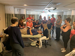 Ann Murley Teaching A Group At Omaha Massage Continuing Education Workshops