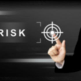 business hand clicking risk button on a