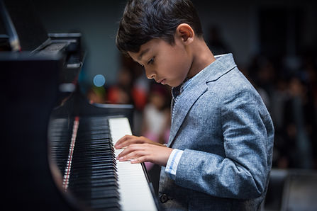 Kid learning piano and perform piano