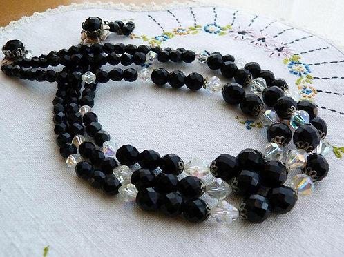 Collier multi rangs en lucite noir et crystal