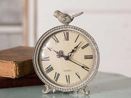 Petite horloge à l'oiseau perché