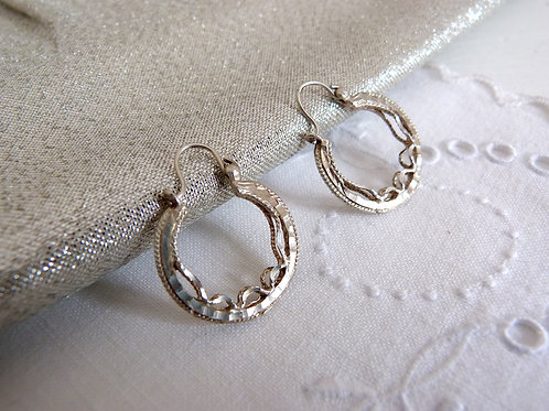 Boucles d'oreille style créoles en argent massif