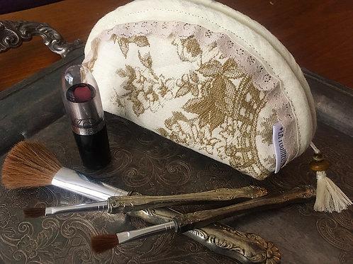 Trousse à maquillage en tissu vintage