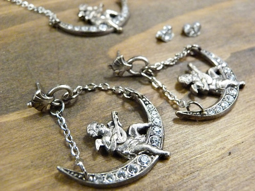 Necklace and earrings set - cherub on the moon
