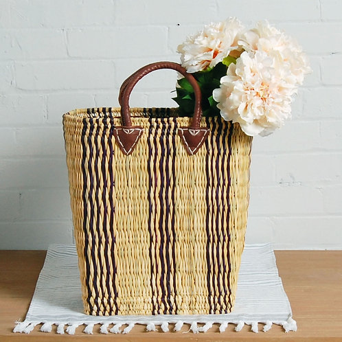 Braided rush basket, leather handles