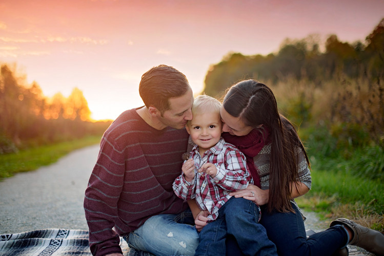 sunset family portrait with baby boy