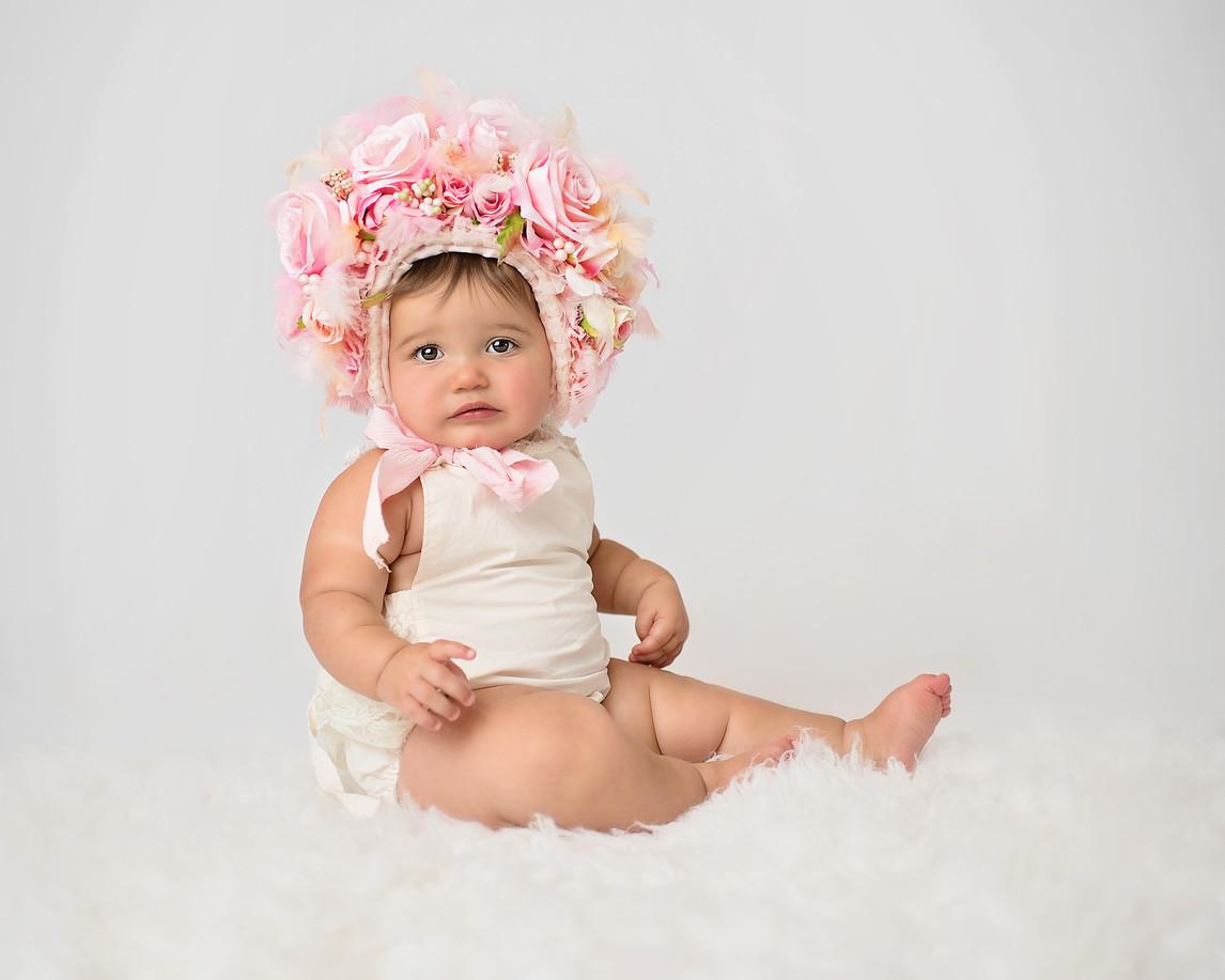 baby in flower bonnet sitter photographer