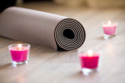 yoga mat with candles.jpg