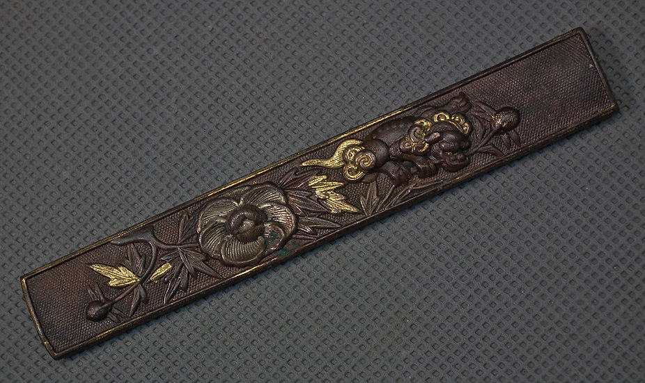 Antique Japanese Samurai Knife Handle Kozuka With a Buddhist Lion Shishi & Flora