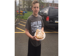 boy with funnel cakes