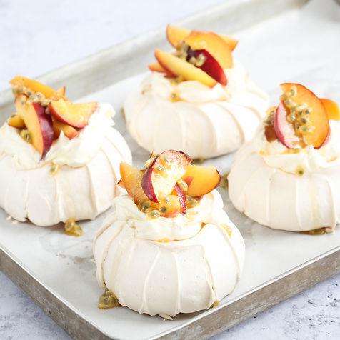 mini pavlovas with honey roast peach, nectarine and passionfruit