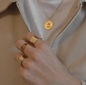 'Melissa' gold necklace Left hand: 'Kos' gold ring , 'Spira' gold ring ,  'Kos' gold ring