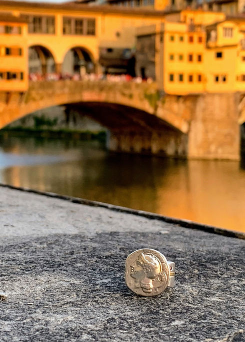 Ancient Athena coin ring pictured on the Ponte Vecchio in Florence, Italy