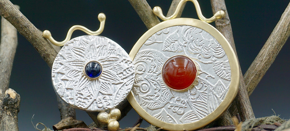 Intricate floral designs etched in silver and accented with gold and gemstones