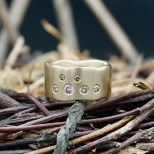 18k gold and champagne diamond wide band ring with an organic edge
