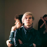 Douglas Kirkland  Director Paul Morissey, Andy Warhol, James Forth and Joe Dalessandro at the Chateau Marmont  Los Angeles, 1970 [printed later]  archival pigment print on watercolor paper, edition of 24, signed, numbered  paper size > 24 x 30 inches