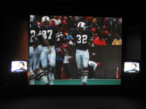 Film and video installation of OJ Simpson football footage and interview with Roger Welch