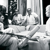"""Douglas Kirkland  Vittorio de Sica, Marcello Mastroianni and Faye Dunaway on the set of """"Amanti (A Place for Lovers), Treviso, Italy  photo 1968 [printed later]  archival pigment print on watercolor paper, edition of 24, signed, numbered  paper size > 24 x 30 inches"""