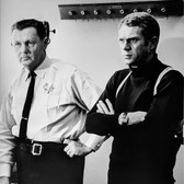 """Photograph by Hatami (1928-2017) Don Gordon and Steve McQueen on the set of """"Bullitt"""" photograph 1968 vintage gelatin silver print, signed, stamped 12 x 8.75 inches"""