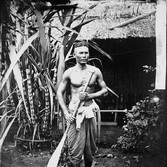 John Thomson (1837-1931)  Young Cambodian Man  photograph 1866 [printed later]  gelatin silver print from the glass negative, edition of 350 16 x 20 inches, stamped