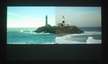 Film still from Roger Welch's video of two lighthouses in Australia changing over 24 hours