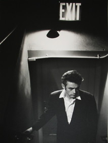 James Dean ascends staircase at ABC studios in New York City below Exit Sign