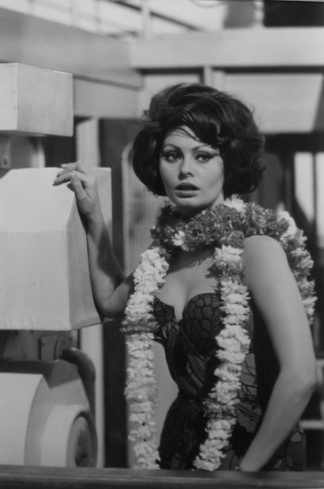"""Sophia Loren on the set of """"A Countess from Hong Kong,"""" 1966 Pinewood Studios, Buckingham Shire vintage gelatin silver print Image Size: 14.5 x 9.5 inches   36.8 x 24.1 cm  Photograph by Hatami (1928-2017)"""