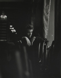 James Dean poses over stacked chairs on the set of 'The Thief' in New York City