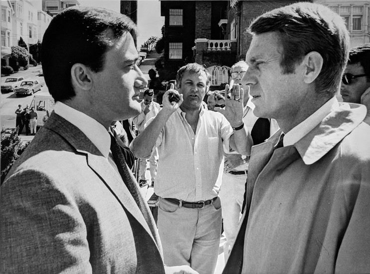 """Robert Vaughn, Steve McQueen and director Peter Yates setting up a shot, on the set of """"Bullitt,"""" 1968 vintage gelatin silver print, signed, stamped Image Size: 8.25 x 11.5 inches   21.0 x 29.2 cm  Photograph by Hatami (1928-2017)"""