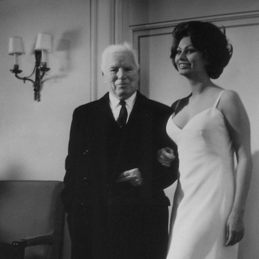 """Photograph by Hatami (1928-2017) Sophia Loren with Charlie Chaplin on the set of """"A Countess from Hong Kong,"""" Pinewood Studios, Buckinghamshire photograph 1966 vintage gelatin silver print, signed, stamped 14.5 x 9.5 inches"""