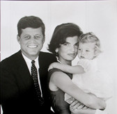 Black & white photograph of JFK with Jackie and child