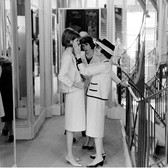 Douglas Kirkland  Coco Chanel with model preparing for the new collection on the second floor, House of Chanel, Paris  photo 1962 [printed later]  archival pigment print, edition of 24, signed  paper size > 20 x 24 inches