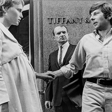 """Photograph by Hatami (1928-2017) Mia Farrow and Roman Polanski setting a scene in front of Tiffany, New York City, on the set of """"Rosemary's Baby"""" photograph 1968 vintage gelatin silver print, signed, stamped 8.2 x 10.75 inches"""