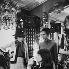 Coco Chanel in her private apartment, House of Chanel, with models  photograph circa 1962-1969 (printed later)  gelatin silver print, AP, signed  image size > 16 x 12 inches  Photograph by Hatami (1928-2017)