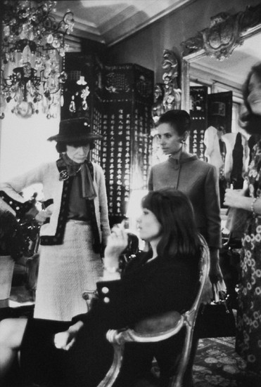 Coco Chanel in her Private Apartment with Models, House of Chanel, rue Cambon, Paris Photograph circa 1962-69 (printed later) gelatin silver print, AP, signed Image Size: 16 x 12 inches   40.6 x 30.5 cm Paper Size: 20 x 16 inches   50.8 x 40.6 cm  Photograph by Hatami (1928-2017)