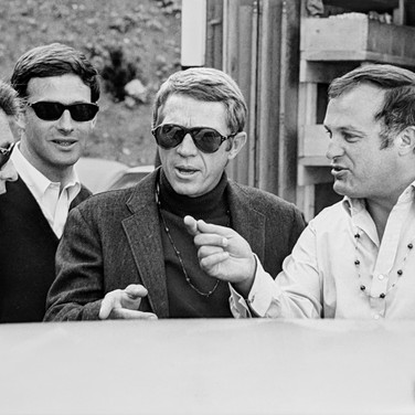 """Photograph by Hatami (1928-2017) Steve McQueen, Peter Yates and crew discussing the next scene, on the set of """"Bullitt"""" photograph 1968 vintage gelatin silver print, signed, stamped 8 x 10.5 inches"""