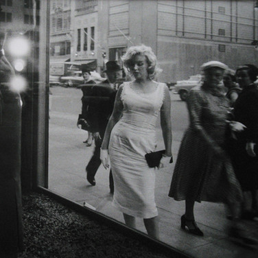 SAM SHAW [1912-1999]  Marilyn Monroe on Fifth Avenue, New York City  photo 1956 [printed later]  gelatin silver print, AP, stamped by the Estate paper size > 15 x 19.75 inches