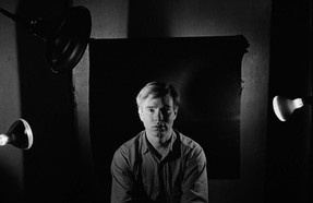 Bob Adelman (1930-2016) Andy Warhol posing with the portrait lighting at the Factory photograph 1965 (printed later) archival pigment print, edition 1/20, signed paper size > 14.5 x 22 inches