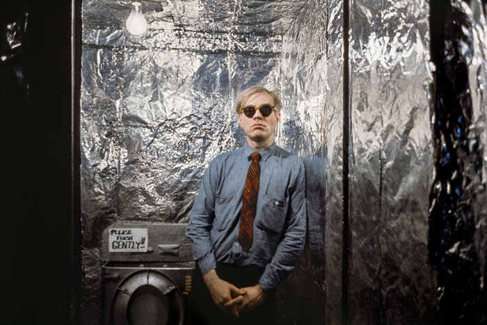 BOB ADELMAN (1930-2016) Andy Warhol in the silver-foil covered bathroom at the Factory photograph 1965 [printed later] archival pigment print, AP, signed Paper Size: 12 x 16 inches | 30.5 x 40.6 cm