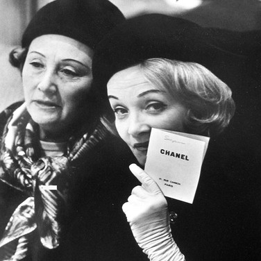 Marlene Dietrich at a fashion presentation at the House of Chanel  photograph circa 1962-1969 (printed later)  gelatin silver print, AP, signed  image size > 14.5 x 9 inches  Photograph by Hatami (1928-2017)