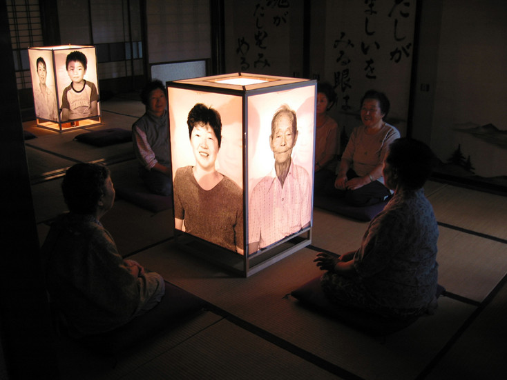 NOBUHO NAGASAWA See-Through Eyes (2003) wood, photographs, light ten lanterns; dimensions variable  Installation view from 2nd Echigo-Tsumari Art Triennial, Minamiabuzaka, Niigata, Japan, 2003.