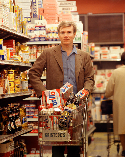 BOB ADELMAN (1930-2016) Andy Warhol in Gristedes Supermarket, New York City photograph 1965 [printed later]  archival pigment print on Kodak paper, edition of 50, stamped by the Bob Adelman estate Paper Size: 20 x 16 inches | 50.8 x 40.6 cm