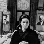 Photograph by Hatami (1928-2017) Geraldine Chaplin as Tonya on the set of Doctor Zhivago (soviet propaganda images in the background) photograph 1965 vintage gelatin silver print, signed, stamped 8.5 x 11 inches
