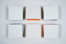 Tridimensional, bas relief painting of white squares with colored backs