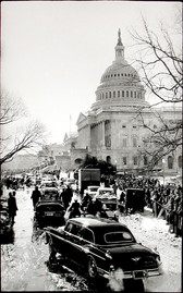 Black & white photograph of official motorcade in Washington DC, Capitol building in the background